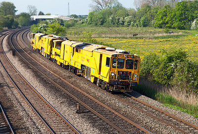A pair of Stoneblowers pass Duffryn running as 6U42 07.37 Llandeilo Junction to Cricklewood Depot. Friday 16th May 2014.