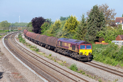 66086 passes Undy with 6B49 08.19 Llanwern to Swindon loaded steel carriers. Friday 16th May 2014.