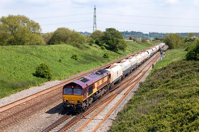 66020 drops downgrade towards the Severn Tunnel past Pilning with 4B35 10.47 Hayes & Harlington to Moreton-on-Lugg empty stone hoppers. Friday 16th May 2014.