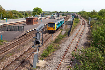 142075 departs from Severn Tunnel Junction forming 2G53 12.18 Cheltenham to Cardiff Central. Sunday 4th May 2014.