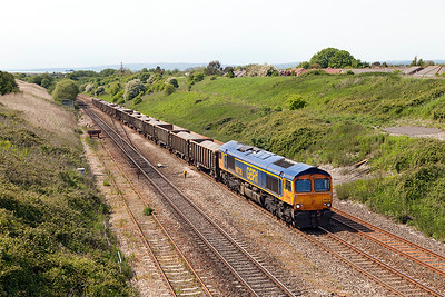 66735 climbs away from the Severn Tunnel past Pilning Village with 6A82 12.47 Moreton-on-Lugg to West Drayton loaded stone. Friday 16th May 2014.