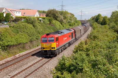 60040 'The Territorial Army Centenary' passes Portskewett with 6V05 10.01 Round Oak to Margam empty steel carriers. Friday 16th May 2014.