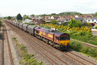 66050 'EWS Energy'  passes Magor with 6O32 10.07 Margam to Dollands Moor loaded steel carriers. Sunday 4th May 2014.