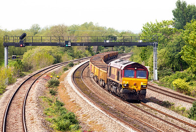 66119 pulls away from a signal check at Undy with 6W16 Cardiff East to Westbury Yard spent ballast. Sunday 4th May 2014.