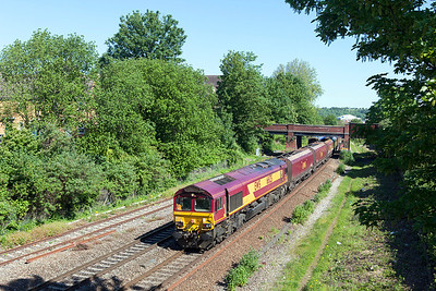 66125 passes Lawrence Hill with 4V83 05.19 Toton North Yard to Portbury Coal Terminal empty hoppers. Wednesday 21st May 2014.
