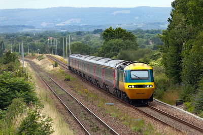43002 (253 001) 'Sir Kenneth Grange' heads the 1L65 13.55 Cardiff Central to Paddington up the gradient from the Severn Tunnel towards the Patchway Tunnels at Cattybrook. 43162 is the rear power car. The masts in the background are the sign of things to come. Tuesday 26th JUly 2016.