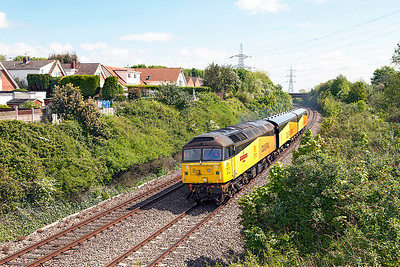 47739 'Robin of Templecombe' passes Portskewett conveying EMU Translator Vehicles 6365 & 6364 repainted into Colas livery having previously been in Regional Railways livery. Running as 5V47 09.00 Washwood Heath to Cardiff Canton. Monday 16th May 2016.