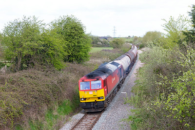 60091 nears the end of it's journey passing Westerleigh Village with 6B13 05.00 Robeston to Westerleigh loaded Murco tanks. Tuesday 3rd May 2016.