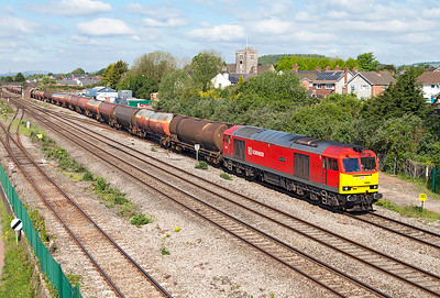 60039 'Dove Holes' (Ex Glastonbury Tor) passes Magor Village with 6B13 05.00 Robeston to Westerleigh loaded Murco tanks. Monday 16th May 2016.