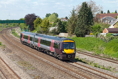 The 1M64 11.45 Cardiff Central to Nottingham passes Undy formed of 170 114. Monday 16th May 2016.