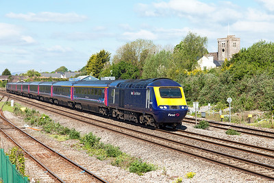 The 1L42 07.30 Carmarthen to Paddington with power cars 43003 'Isambard Kingdom Brunel' and 43063 pass Magor Village. Monday 16th May 2016.