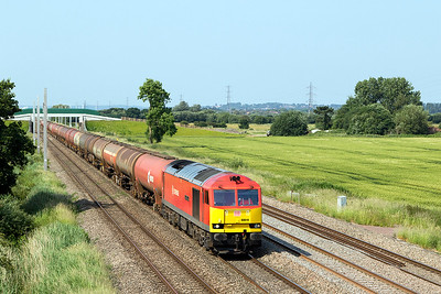 60019 'Port of Grimsby & Immingham' heads the 6B13 05.00 Robeston to Westerleigh loaded Murco tanks past Green Lane, Duffryn. Tuesday 20th June 2017.