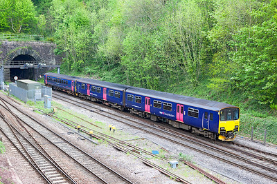 150106 & 153377 emerge from Hillfield Tunnel on the Down Slow forming 2U14 11.04 Taunton to Cardiff Central. Wednesday 3rd May 2017.