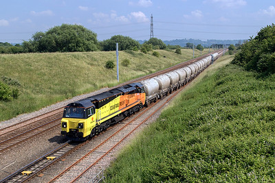 70817 departs from Pilning Loop with 6C36 12.37 Westbury Cement Works to Aberthaw Cement Works empty PCA Cement Tanks. Tuesday 20th June 2017.