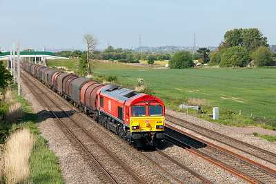 Newly painted 66044 passes Green Lane, Duffryn with 6H35 07.34 Margam to East Usk Birdport Branch loaded covered steel carriers. Wednesday 10th May 2017.