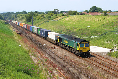 66588 climbs away from the Severn Tunnel passing Pilning with 4O57 13.29 Wentloog to Southampton MCT Freightliner service. Tuesday 20th June 2017.
