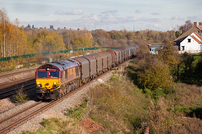 66230 powers away from Severn Tunnel Junction with 6V05 09.16 Round Oak to Margam empty steel carriers. Friday 11th November 2016.