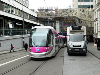 Midland Metro CAF Urbos 3 tram, 17 heads away from the terminus at Grand Central and approaches Corporation Street forming a service to Wolverhampton. Saturday 29th October 2016.