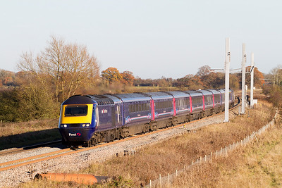 43143 'Stroud 700' & 43017 'Hannahs, discoverhannahs.org' have charge of 1C13 12.00 Paddington to Bristol Temple Meads passing the new masts at Shrivenham. Friday 25th November 2016.