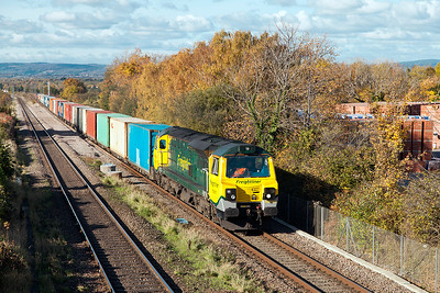 Having sat in Pilning Loop for 100 minutes due to the axle counter failure in Patchway Tunnel, 70015 accelerates past Cattybrook with 4O70 09.56 Wentloog to Southampton MCT Freightliner service. Wednesday 2nd November 2016.