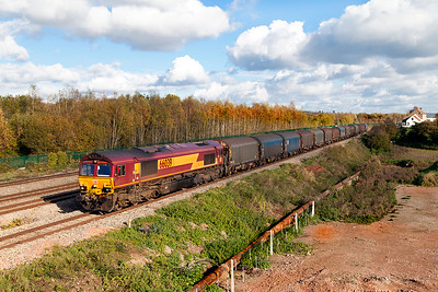 66039 passes Church Road, Undy with 6V05 09.16 Round Oak to Margam empty steel carriers. Monday 7th November 2016.