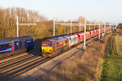As 43171 passes with 1L65 13.55 Cardiff Central to Paddington 66082 heads the 6Z47 12.55 Wembly Euro Freight Ops Centre to Cardiff Ryans Dock empty stone hoppers along Challow Loop at Denchworth. Friday 25th November 2016.