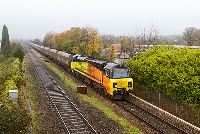 70013 heads through the autumn mist passing Cattybrook with 4C21 10.15 Aberthaw Power Station to Avonmouth Coal Silo empty hoppers. Thursday 26th October 2017.