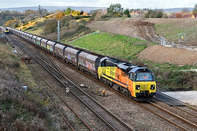 70807 climbs away from the Severn Tunnel with 4C21 10.15 Aberthaw Power Station to Avonmouth BHT empty coal hoppers. Friday 10th November 2017.