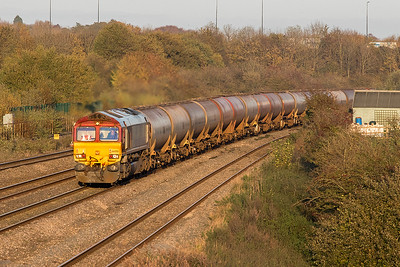 66050 'EWS Energy' powers round the curve from Severn Tunnel Junction approaching UNdy with 6B33 13.00 Theale to Robeston empty tanks. Friday 27th October 2017.