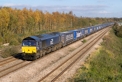 66433 passes Undy with 4V44 10.47 Daventry to Wentloog Stobart Rail Tesco service. Friday 27th October 2017.