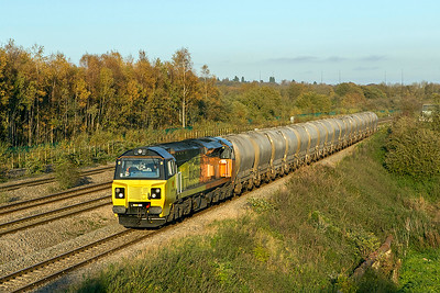 70816 runs along the down relief at Undy with 6C37 15.28 Westbury Cement Works to Aberthaw Cement Works empty PCA tanks. Friday 27th October 2017.