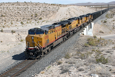 UP 6506 (C44AC), UP 7090 (C44/60AC), UP 6066 & UP 5960 head south down the Salt Lake route with a unit loaded coal train and are north of Jean. 04/05/2007.