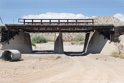 An interesting use of an old UP flat wagon body as a bridge deck on the service road adjacent to the UP Salt Lake route about 60 miles north of Las Vegas. 03/05/2007.