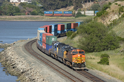 BNSF 5080 (C44-9W), CSX 8783 (SD60M) & CSX 8026 (SD40-2) wind their doublestack train around San Pablo Bay at Pinole on Wednesday 5th May 2007.