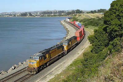UP 4008 & UP 4677 (both SD70M's) pass Pinole with an Oakland bound double stack train. 09/05/2007.