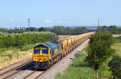 66615 leads 6Y11 09.20 Abbotswood Junction to Fairwater Yard returning the HOBC from an overnight possession with 66613 dead on the rear passing Middle Street, Brent Knoll running some 80 minutes early. Sunday 22nd July 2012.