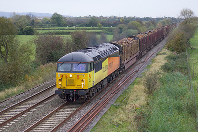 56094 passes Wick Road, Hewish with 6Z53 14.41 Teigngrace to Chirck loaded timber carriers. Thursday 25th October 2012.