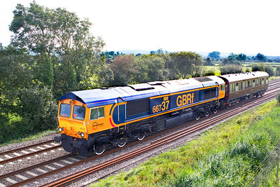 66737 'Lesia' returns the 2Z02 15.05 Bishops Lyseard to Bristol Parkway inspection saloon 6320 past Wick Road, Hewish. Saturday 8th September 2012.