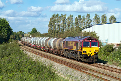 66066 passes Oldmixon on the Weston-super-Mare avoiding line with 6C62 15.31 St. Phillips Marsh to Tavistock Junction fuel tanks Ex Fawley. Tuesday 18th September 2012.