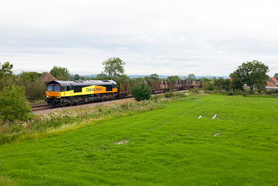 66846 passes Wick Road, Hewish with 6Z52 08.11 Chirk to Teigngrace empty log train. Wednesday 8th August 2012.
