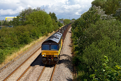 66846 heads the 6Z52 08.11 Chirk to Teigngrace empty log train past Hutton Moor on the Weston-super-Mare avoiding line. Wednesday 11th July 2012.