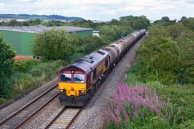 66002 'Lafarge Quorn' passes Winterstoke Road on the Weston-super-Mare avoiding line with 6C62 15.31 TO St. Phillips Marsh (Ex Fawley) to Tavistock Junction fuel tanks. Tuesday 14th August 2012.