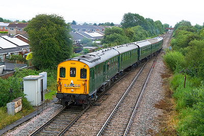 Hastings Diesels Ltd 'Channel Two' Railtour 1Z51 07.05 Hastings to Weston-super-Mare crosses over at Worle Junction to take the loop line into Weston formed of Thumper Unit 1001. The power car this end has a full yellow front. The narrow gauge of the Hasting unit shows up well against the middle two MK1's. Saturday 7th July 2012.