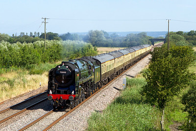70000 ' Britannia' passes Middle Street, Brent Knoll with the 'Torbay Express' from Bristol to Kingswear. Sunday 22nd July 2012.