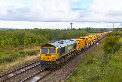 66621 leads the High Output Ballast Cleaner past Middle Street, Brent Knoll as 6Y11 Standish Junction to Taunton Fairwater Yard with 66614 dead on the rear. Sunday 8th September 2013.