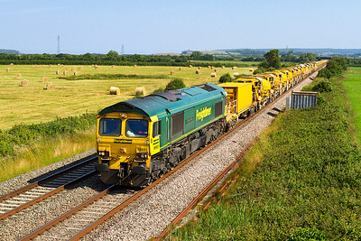 66601 'The Hope Valley' leads the High Output Ballast Cleaner past Brean Road, Lympsham from a possession north of Ashchurch returning to Taunton Fairwater Yard as 6Y11. 66613 is dead on the rear. Sunday 7th July 2013.