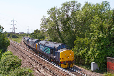 With the mainline obviously out of use 37688 'Kingmoor TMD' & 37610 'T.S. (Ted) Cassaday 14.5.61 - 6.4.08' with failed 37605 & 37609 come off the Weston-super-Mare loop at Worle Junction with FNA's 550028, 550056 & 550054 forming the 6M67 14.02 Bridgwater Yard to Crewe Coal Sidings. Even 37610 managed to fail before leaving Bridgwater so 37688 had to lead back as well. Thursday 4th July 2013.