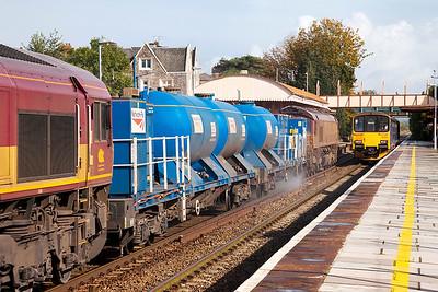 RHTT 3S59 returning to Bristol Barton Hill from Weston-super-Mare passes through Yatton station as 150106 forming 2Y16 12.12 Bristol Parkway to Weston-super-Mare departs. Thursday 17th October 2013.