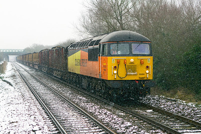 56094 passes Worle Parkway in the snow with 6Z52 07.13 Chirk Kronospan to Teigngrace empty log train. Wednesday 23rd January 2013.