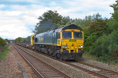 66559 powers past Worle Parkway with an empty welded rail carrier as 6Y27 12.20 Eckington Loop to Newton Abbot Hackney Yard via Newport ADJ Yard running 74 minutes early. Sunday 8th September 2013.